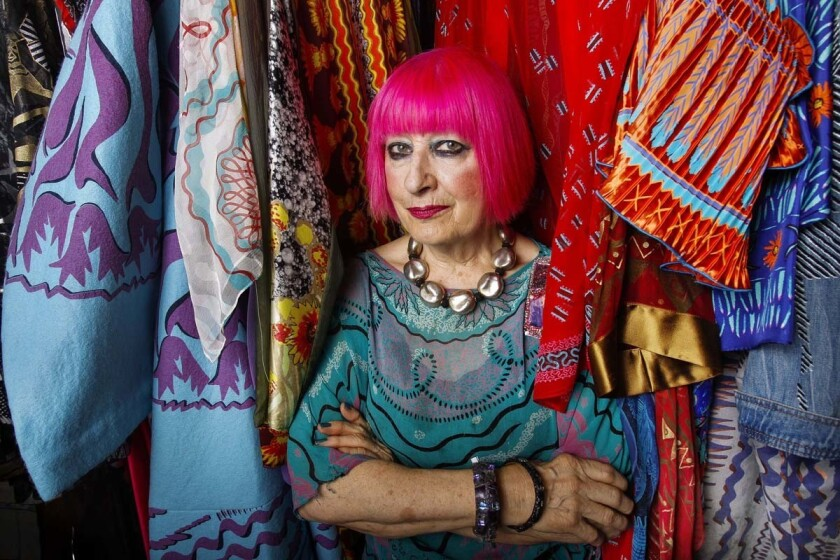 Internationally-known designer Zandra Rhodes among her clothes at her studio in Solana Beach on Friday. (Hayne Palmour IV Union-Tribune)
