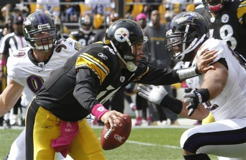 Pittsburgh Steelers quarterback Charlie Batch (16) tries to ward off Baltimore Ravens defensive tackle Haloti Ngata, front right, as defensive end Paul Kruger (99) pursues before a sack in the first quarter of an NFL football game, Sunday, Oct. 3, 2010, in Pittsburgh. (AP Photo/Keith Srakocic)