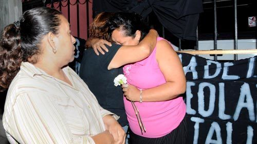 Relatives of death row inmate Jose Medellin try to comfort one another in the border city of Nuevo Laredo, Mexico, where Medellin was born. Medellin was executed in Huntsville, Texas.