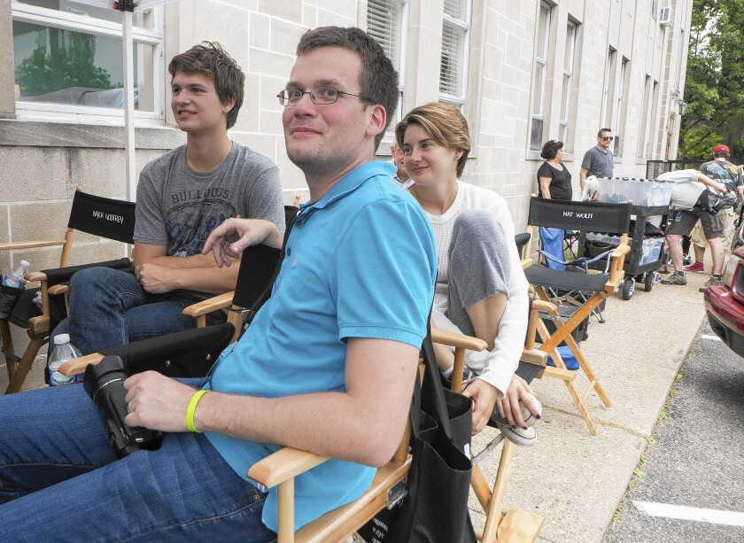 """Author John Green with Ansel Elgort and Shailene Woodley on the set of the movie """"The Fault in Our Stars."""""""