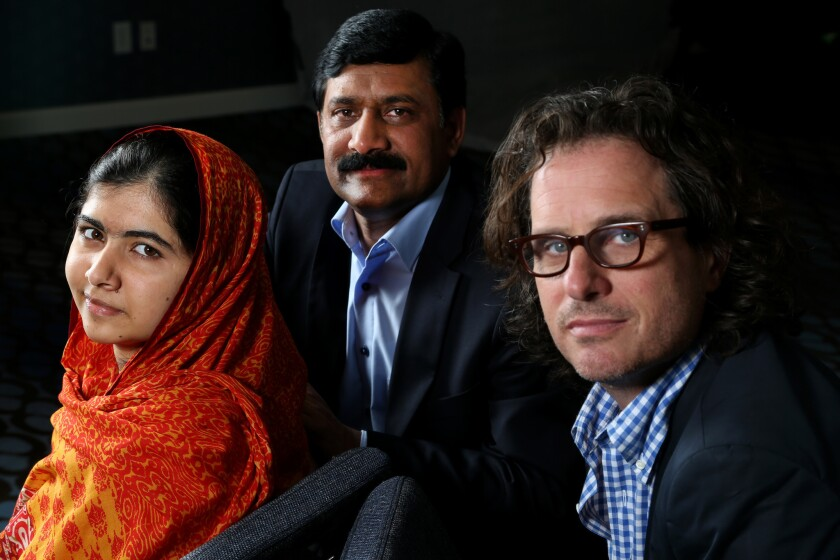 Pakistani teenager Malala Yousafzai, left, has emerged as a leading advocate for children's rights and the youngest-ever Nobel Peace Prize laureate. She is with her father Ziauddin Yousafzai, and director Davis Guggenheim, right.