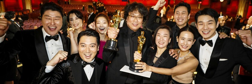 "The cast of ""Parasite"" — and Filmmaker Bong Joon Ho, center — celebrate."