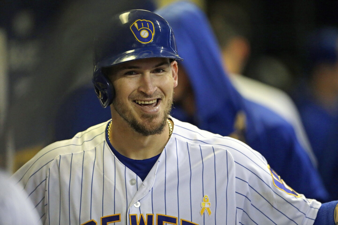 FILE - In this Sept. 7, 2019, file photo, Milwaukee Brewers' Yasmani Grandal smiles in the dugout after hitting a solo home run during the eighth inning of a baseball game against the Chicago Cubs, in Milwaukee. All-Star catcher Yasmani Grandal agreed to a $73 million, four-year contract with the Chicago White Sox, finding a more lucrative free-agent market now that he no longer is burdened by draft-pick compensation. Grandal will earn $18.25 million annually as part of the deal announced Thursday, Nov. 21, 2019. (AP Photo/Aaron Gash, File)