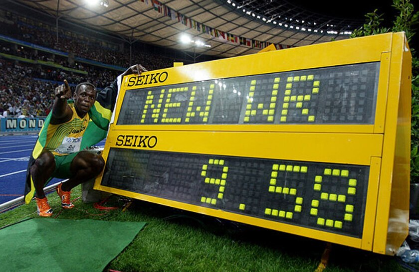 Usain Bolt celebrates after setting a new world record in the 100-meter dash at the IAAF World Athletics Championships in Berlin back in 2009. The shoes he wore in the race have been stolen from a display in England.