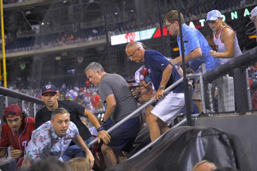 Fans rush to evacuate baseball game in Washington, D.C., following gunfire.