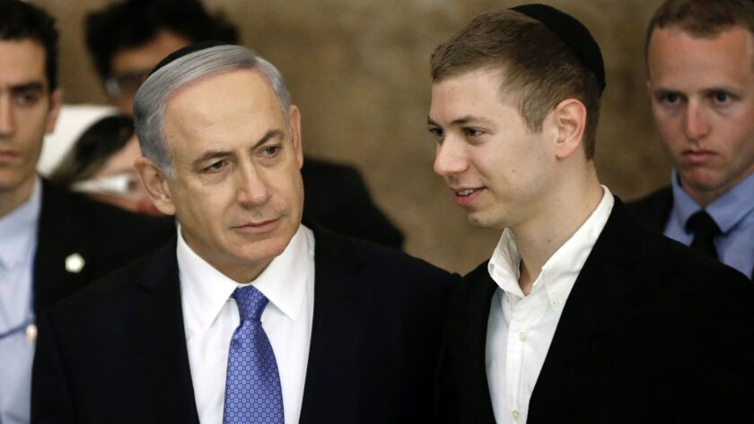 Israeli Prime Minister Benjamin Netanyahu and son Yair, right, at the Western Wall in Jerusalem on March 18, 2015.