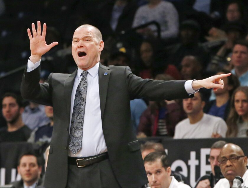 Denver Nuggets head coach Michael Malone gestures toward his players in the first half of an NBA basketball game against the Brooklyn Nets, Monday, Feb. 8, 2016, in New York. (AP Photo/Kathy Willens)