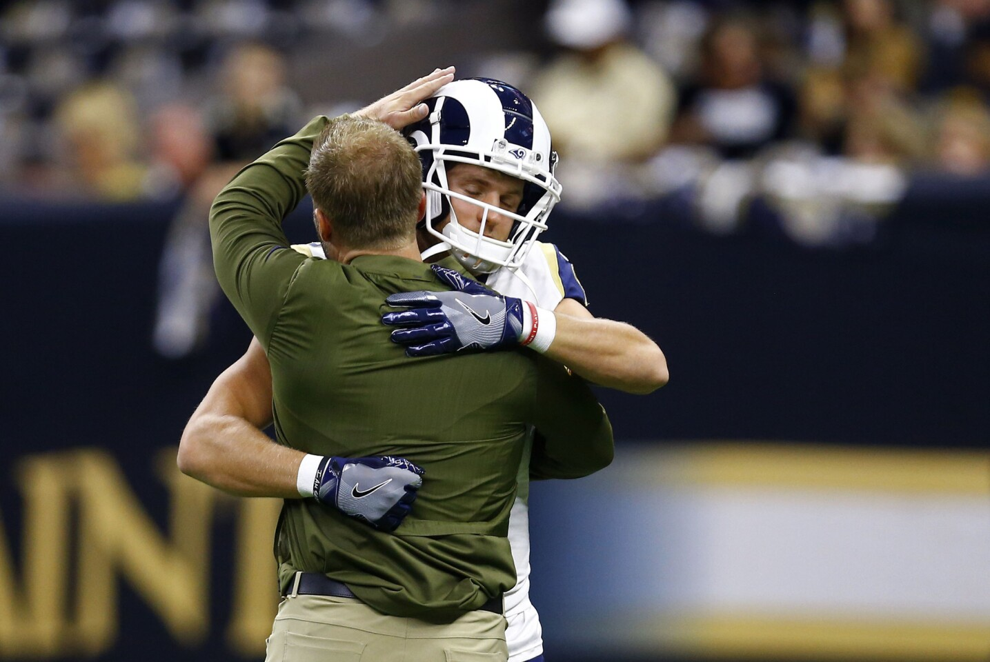 Los Angeles Rams head coach Sean McVay, left, hugs wide receiver Cooper Kupp before an NFL football game against the New Orleans Saints in New Orleans, Sunday, Nov. 4, 2018.