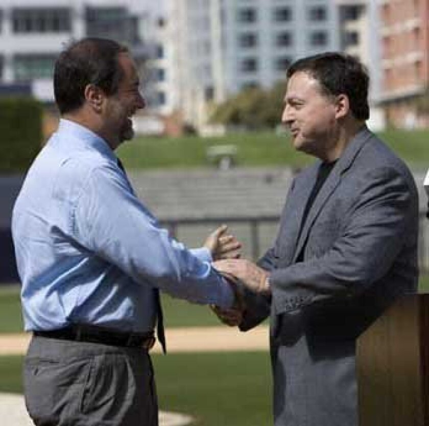 Does the organization new Padres CEO Jeff Moorad (left) is inheriting from John Moores need to be revamped?