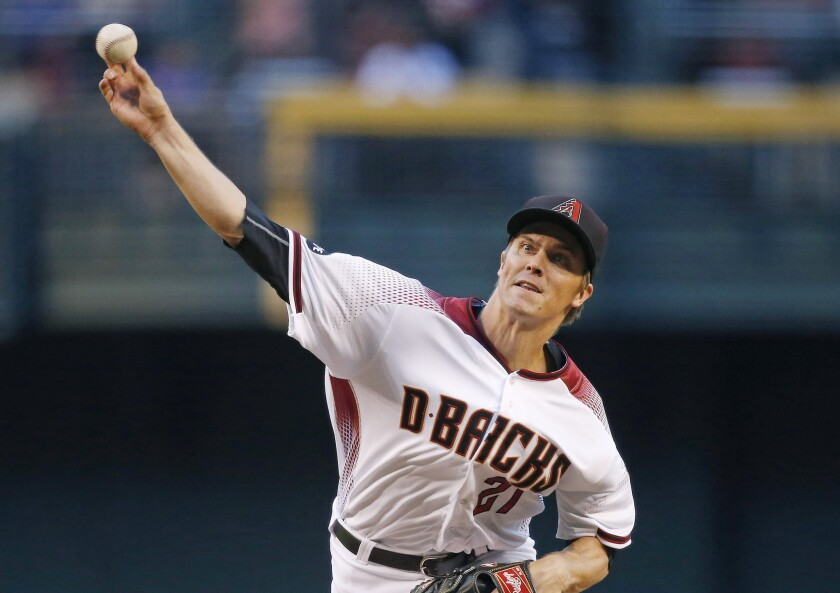 Diamondbacks right hander Zack Greinke throws a pitch against the Dodgers during the first inning.