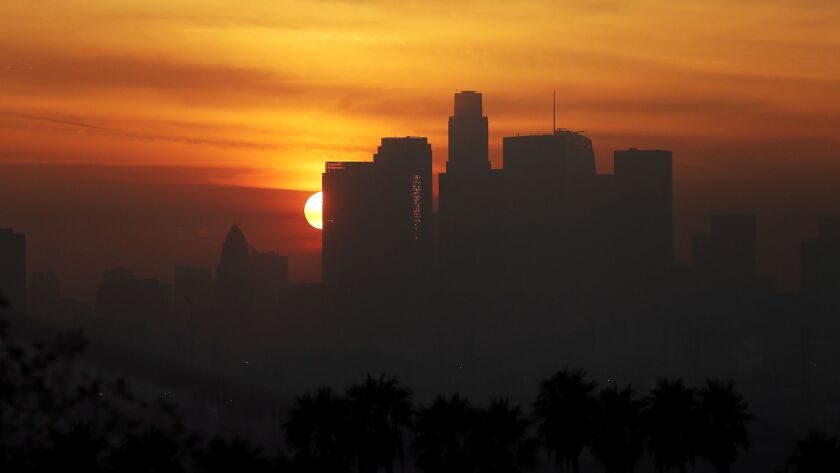 LOS ANGELES, CALIF. DEC. 14, 2016. The sun sets behind the downtown Los Angeles skyline as the mari
