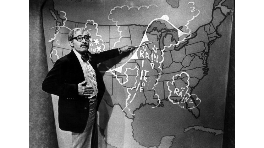 Dr. George Fischbeck getting ready for a nighly weather report, October 26, 1978. Fischbeck, a scien