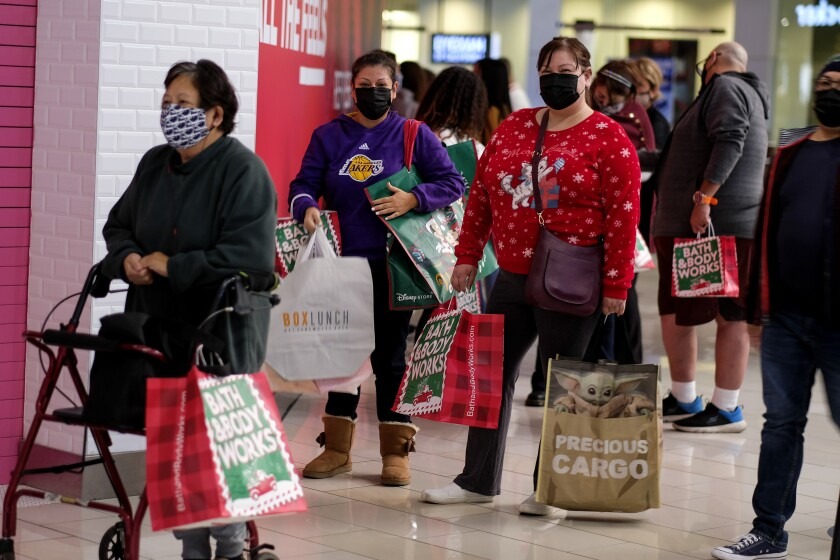 Shoppers wait in line to enter a store at the Glendale Galleria on the Friday after Thanksgiving.