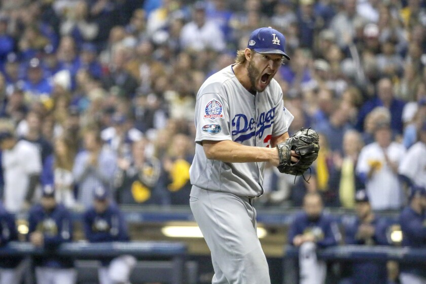 Clayton Kershaw vehemently expresses himself after the third inning where the Milwaukee Brewers scored two runs in Game 1 of the NLCS.