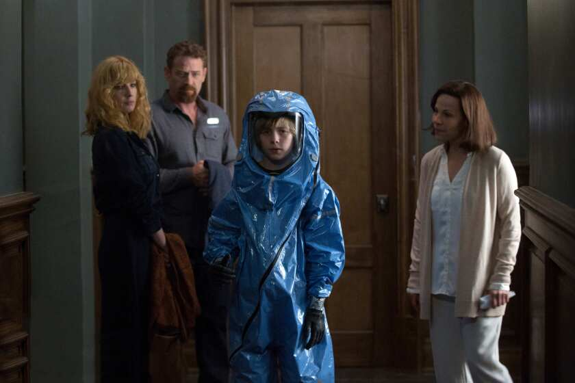 "Kelly Reilly, from left, Max Martini, Charlie Shotwell (in a blue HAZMAT-style suit) and Lili Taylor in ""Eli."""