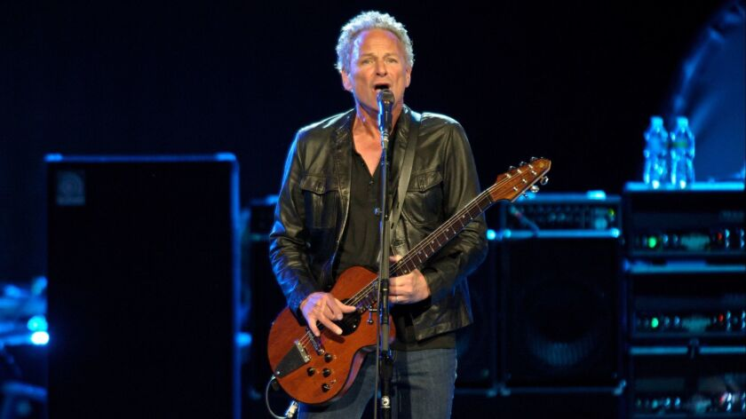Lindsey Buckingham, seen performing with Fleetwood Mac in Washington, D.C. in 2013, may or may not have been fired from the band.