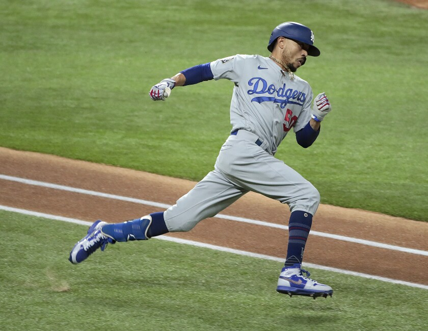 Dodgers right fielder Mookie Betts hustles to second base for a double in Game 5 of the World Series.