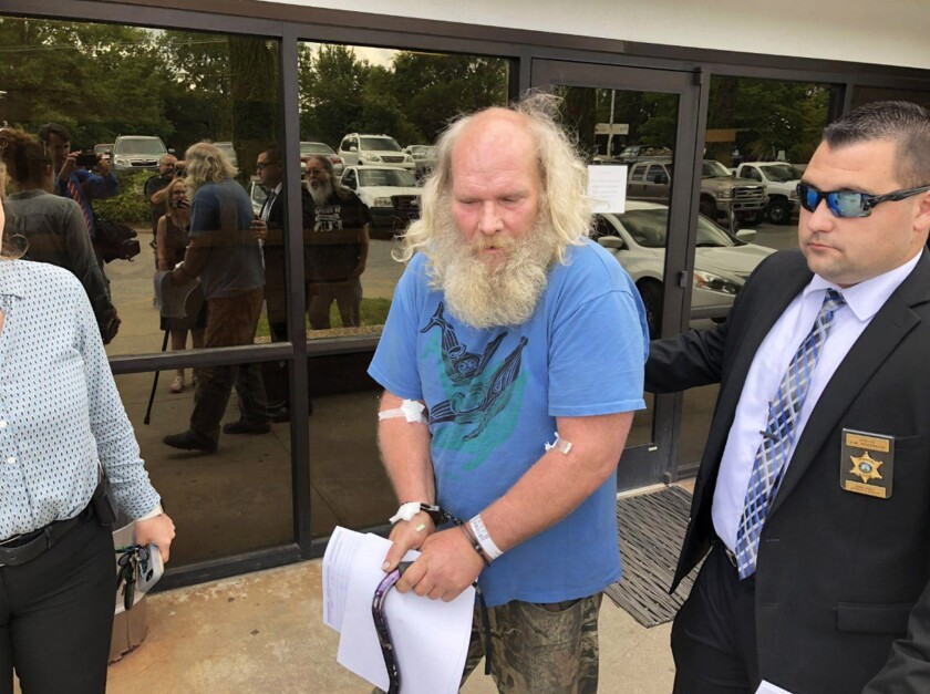 Suspect Edwin Hiatt after his arrest in Burke County, N.C. Hiatt has been charged with bludgeoning and strangling TV director Barry Crane more than three decades ago. The FBI arrested Hiatt after DNA evidence linked him to the 1985 killing in Los Angeles.