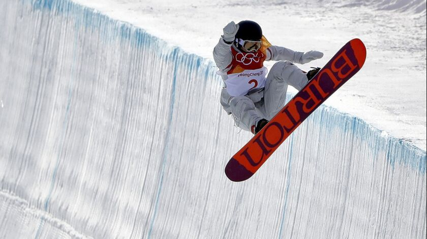 FILE - In this Feb. 12, 2018, file photo, Kelly Clark competes in the women's halfpipe qualifying at