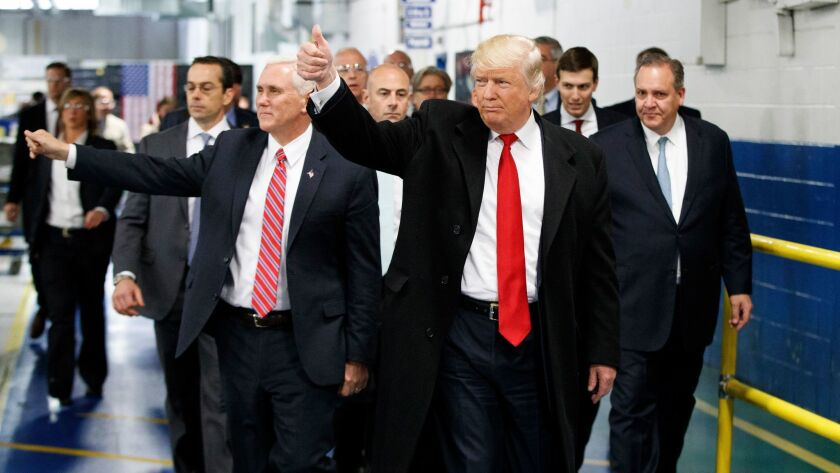 President-elect Donald Trump and Vice President-elect Mike Pence visit the Carrier manufacturing plant in Indianapolis after the company agrees to retain 1,000 jobs there rather than shifting them to Mexico. there