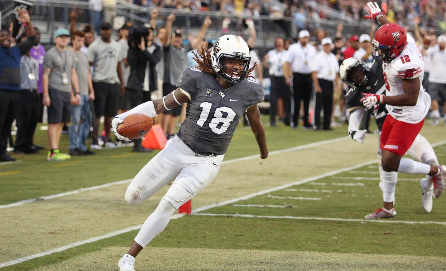 UCF linebacker Shaquem Griffin (18) returns a fumble for a touchdown during the Austin Peay at UCF college football game at Spectrum Stadium in Orlando on Saturday, October 28, 2017. (Stephen M. Dowell/Orlando Sentinel)