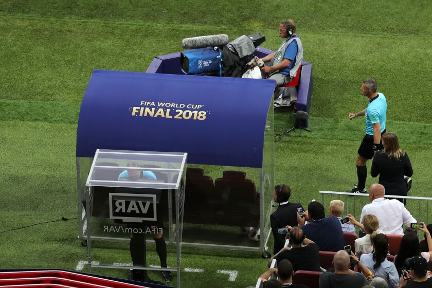 Referee Nestor Pinata reviews VAR footage before awarding France a penalty during the 2018 FIFA World Cup Final between France and Croatia at Luzhniki Stadium on July 15, 2018 in Moscow, Russia.