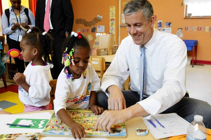 """Education Secretary Arne Duncan visits a Louisville, Ky., school last month. """"I actually use the California model, and not in a good way, as I travel the country,"""" he said."""
