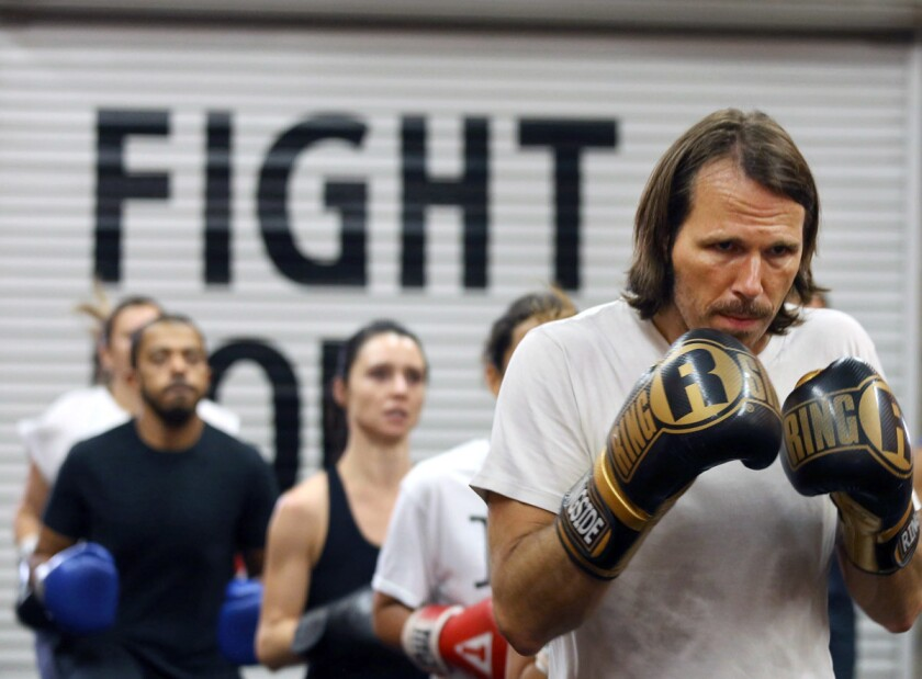 LOS ANGELES CA. August 2, 2017: Steve O'Brien and other class members are ready to start their workout at the boxing fitness class at Prevail Boxing in Los Angeles on August 2, 2017. (Glenn Koenig/Los Angeles Times)