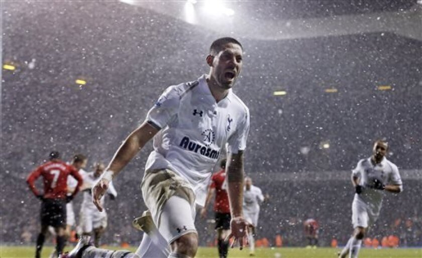 FILE - In this Jan 20, 2013, file photo, Tottenham Hotspur's Clint Dempsey celebrates after scoring a goal against Manchester United during an English Premier League soccer match at White Hart Lane stadium in London. Dempsey is returning to Major League Soccer, ending his six-year spell in English soccer.The 30-year-old Dempsey played for the New England Revolution from 2004-06 before joining Fulham in 2007. He moved to Tottenham last summer and scored 12 goals in 43 games, but wasn't a regular.