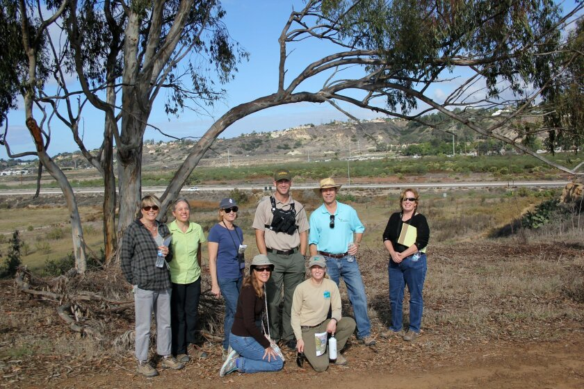 The Gonzales Canyon canyon enhancement planning group went on a field visit on Nov. 12. Shawna Anderson, principal planner for the San Dieguito River Park; Laura Ball, senior planner with the city; resident Andra Davis; Senior Park Ranger Ed Christensen; Eric Bowlby, executive director of San Diego Canyonlands; and Freddy Arthur, field supervisor for San Diego Canyonlands. Kneeling: resident Linda Zlotnik and Natalie Borchardt, senior ranger for San Dieguito River Park.