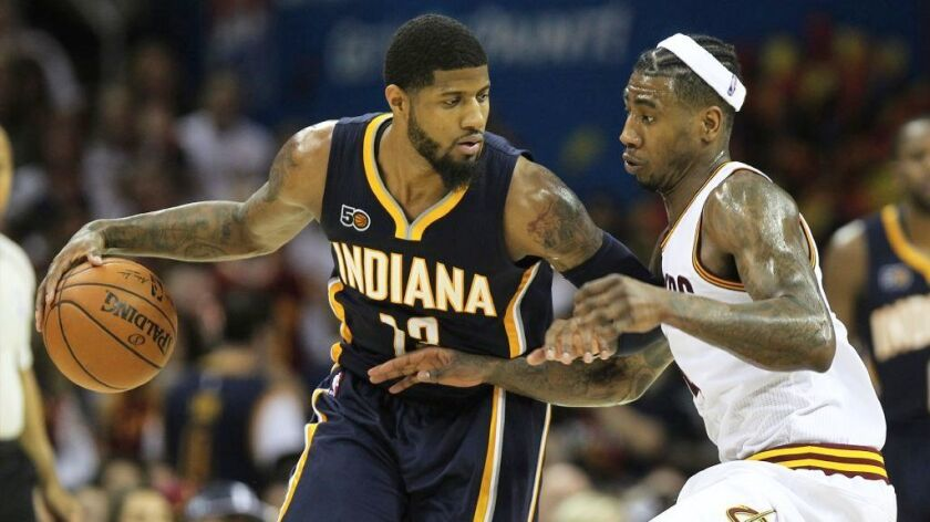 Pacers forward Paul George works against Cavaliers guard Iman Shumpert during a playoff game on Apri
