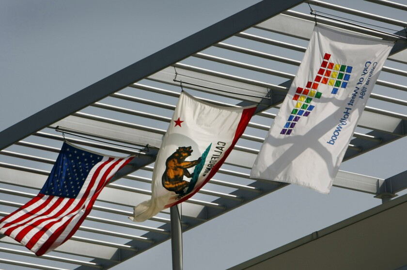 The logo flag flies over the rooftop of the West Hollywood City Hall located on Santa Monica Boulevard in West Hollywood.