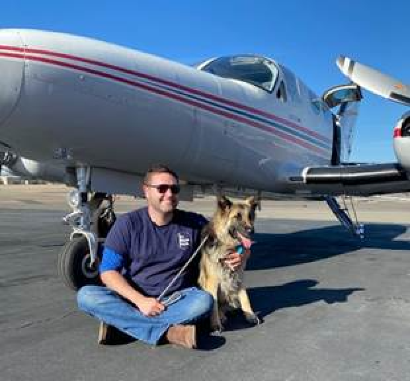 Chloe with a pilot from the rescue group Pilots for Paws.