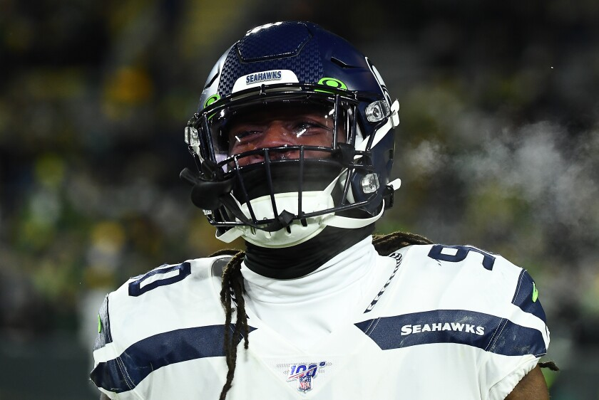 Seahawks defensive end Jadeveon Clowney looks on before a playoff game against the Packers on Jan. 12, 2020.