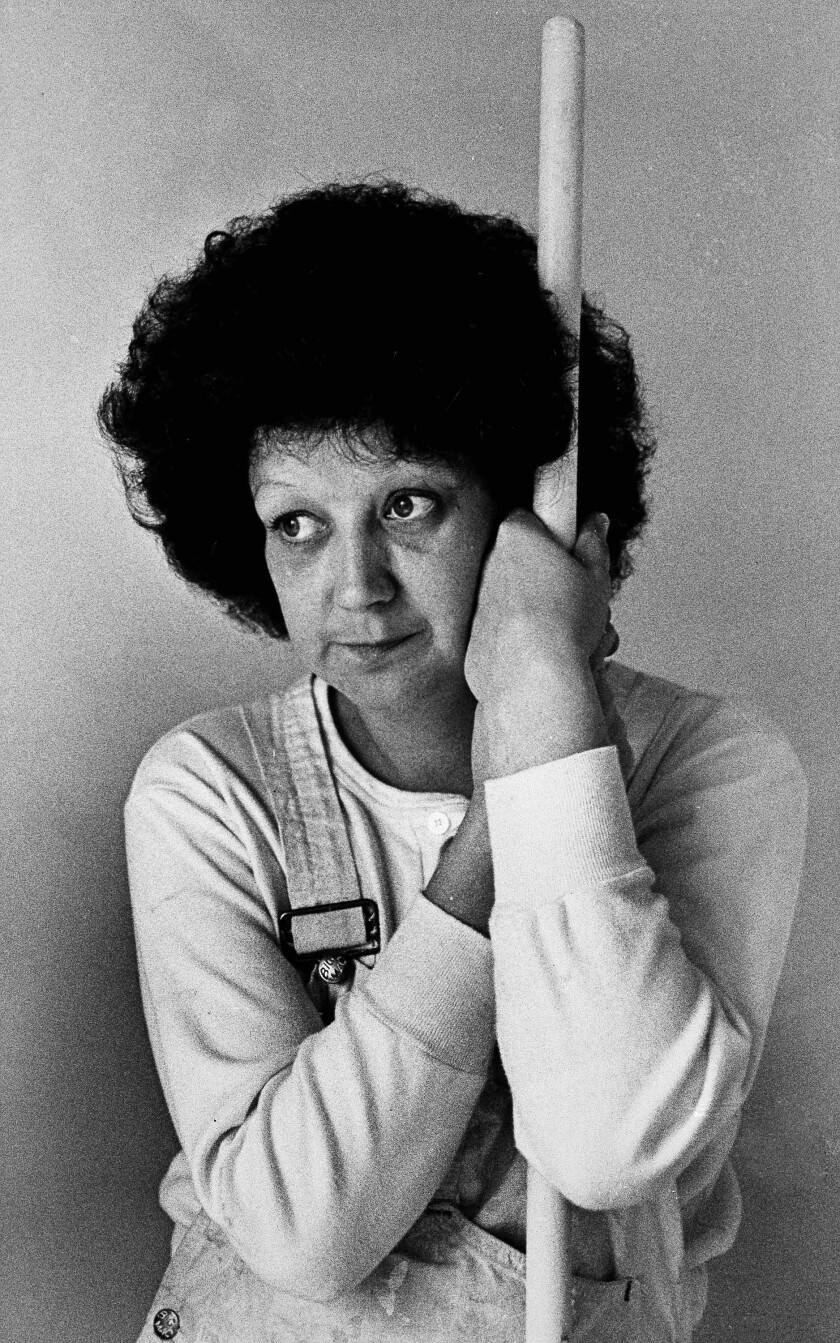 """Norma McCorvey, 35, the Dallas mother whose desire to have an abortion was the basis for a landmark Supreme Court decision a decade ago, takes time from her job as a house painter to pose for a photograph in Terrell, Texas, on Thursday, Jan. 21, 1983. To legal scholars, she is simply """"Jane Roe."""""""