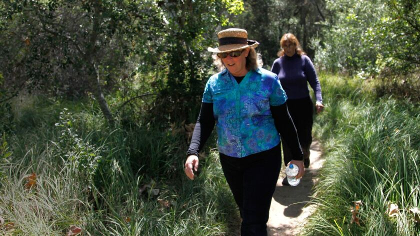 "Debbie Veale of Poway goes for a hike at Los Penasquitos Canyon Preserve. Since she was laid of a year ago, Veale has become taken on hiking and bird watching as hobbies. ""It helps with the stress,"""