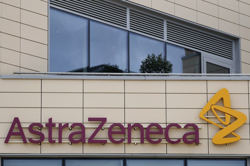 AstraZeneca's logo is seen on the outside of a building.