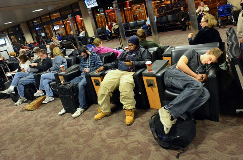 Travelers wait for a flight at Phoenix Sky Harbor Airport in Phoenix on Tuesday.