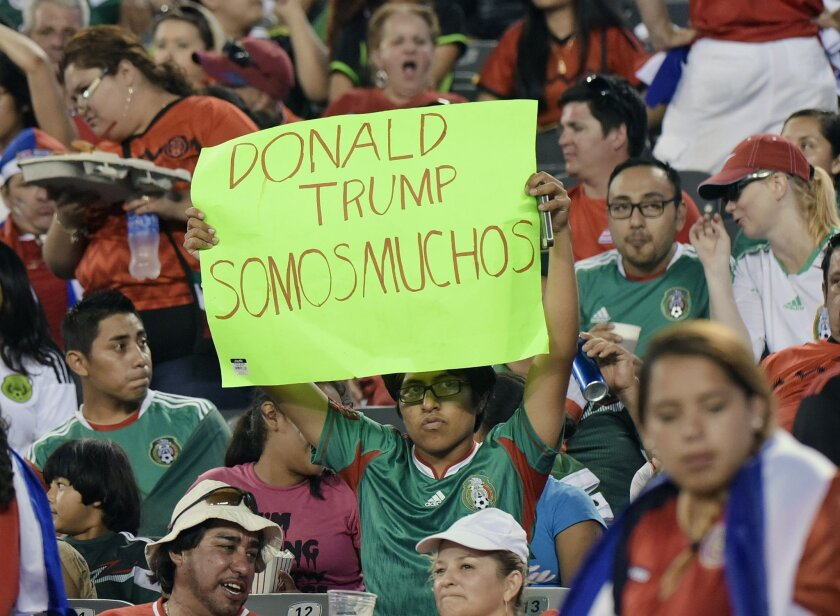 A fan holds a sign during the second half of a CONCACAF Gold Cup soccer match between Mexico and Costa Rica Sunday, July 19, 2015, at MetLife stadium in East Rutherford, N.J. (AP Photo/Bill Kostroun)
