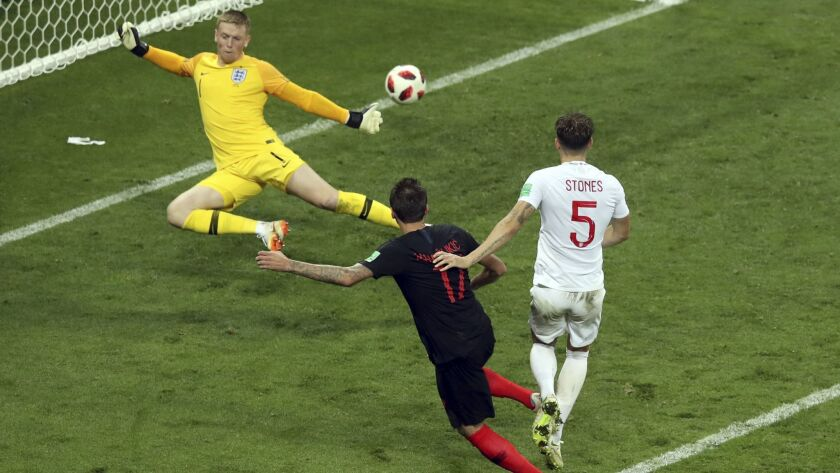 Croatia's Mario Mandzukic, 2nd right, scores his side's second goal during the semifinal match betwe