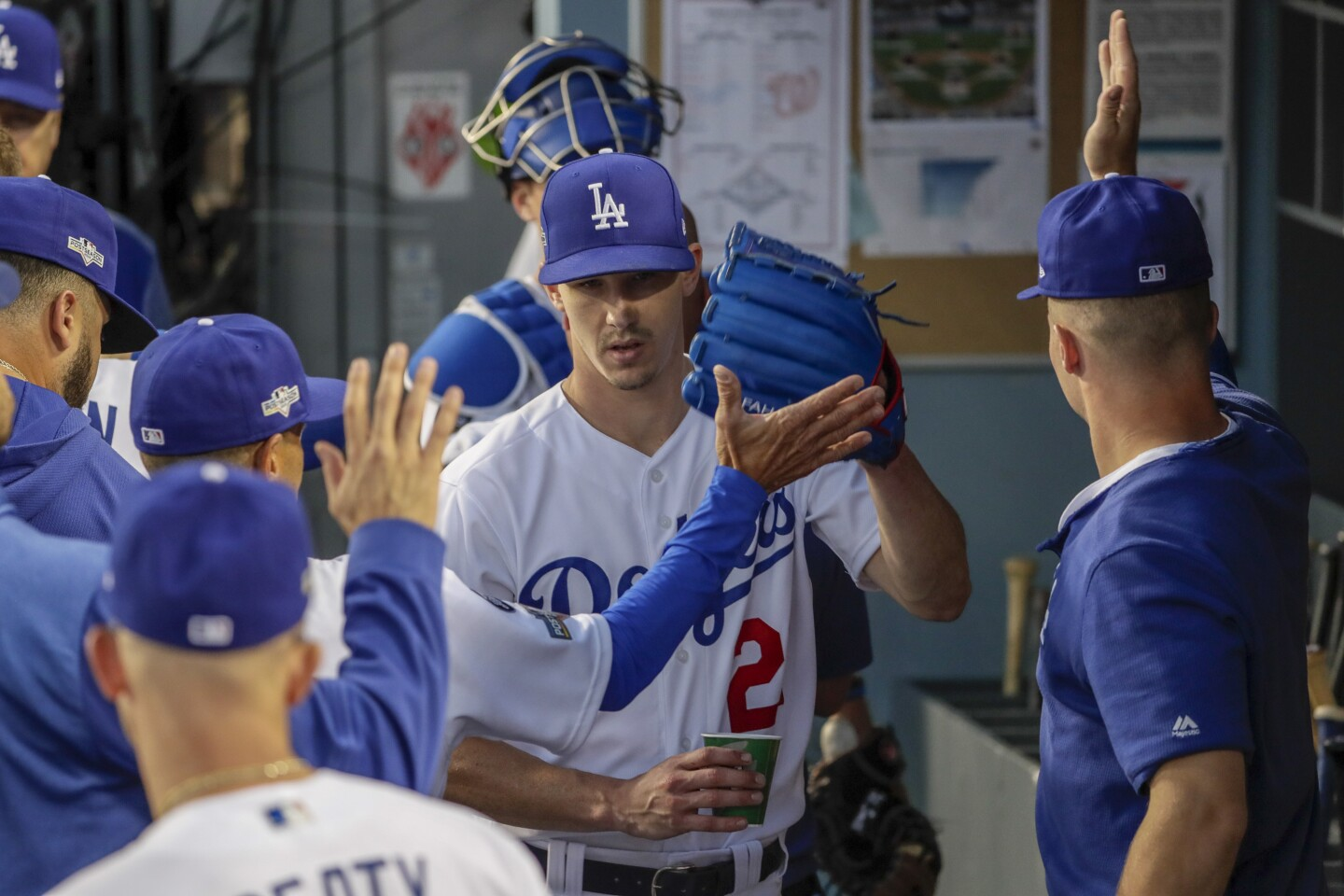 LOS ANGELES, CA, THURSDAY, OCTOBER 3, 2019 - Los Angeles Dodgers starting pitcher Walker Buehler (21) is greeted in the dugout after pitching the third inning against the Nationals in game one of the National League Division Series at Dodger Stadium. (Robert Gauthier/Los Angeles Times)
