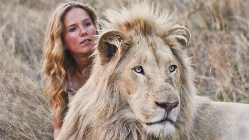 """(L-R)- Daniah de Villiers with Thor in a scene from """"Mia and the White Lion."""" Credit: Coert Wiechers"""