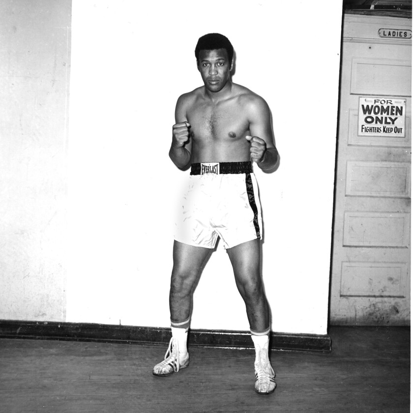 Boxer Jimmy Ellis is seen in this posed action shot at training facilities in Miami Beach, Fla., whi