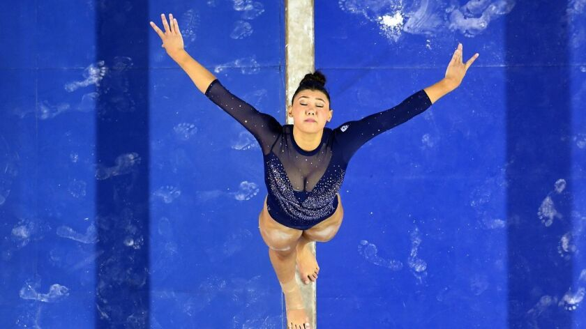 LOS ANGELES, CALIFORNIA MARCH 23, 2019-UCLA gymnast Kyla Ross competes on the beam at Pauley Pavilio