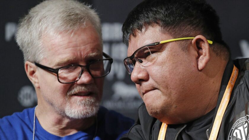 Buboy Fernandez, right, and Freddie Roach speak at a news conference for an upcoming fight between M