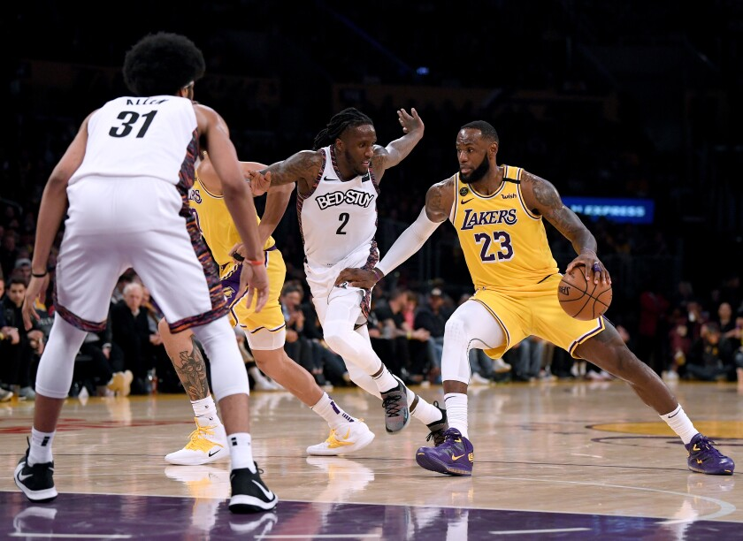 Lakers forward LeBron James drives against the Nets on March 10, 2020, during both teams' final game before suspension of play in the NBA.