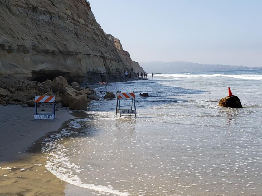 Photo of large sandstone rocks at the base of a bluff at Torrey Pines State Beach on Saturday.
