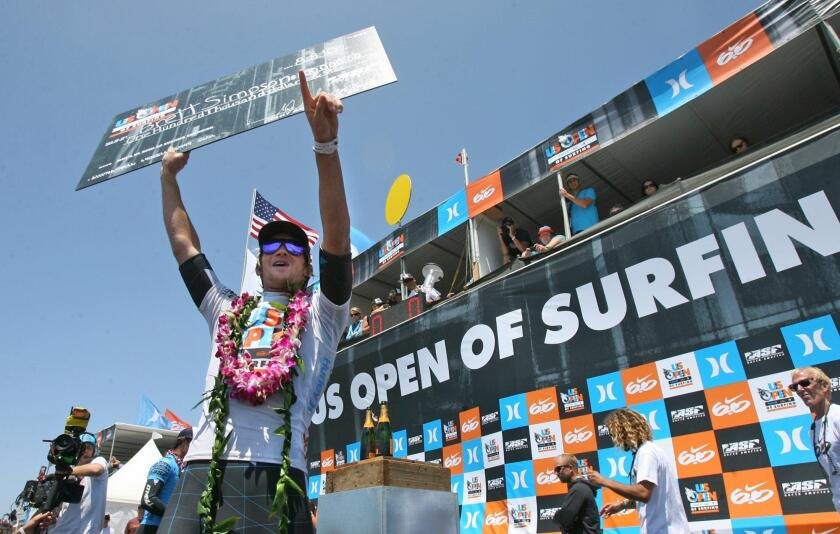 Huntington Beach local Brett Simpson celebrates his second consecutive U.S. Open of Surfing men's championship.