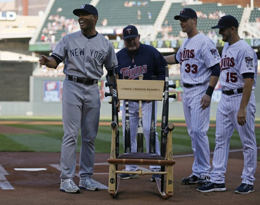 Mariano Rivera, left, says the rocking chair made partially of broken bats presented to him by the Minnesota Twins on July 2 is the funniest gift he has received on his farewell tour.