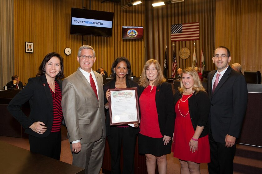 Dr. Pam Taub (center) with friends at UCSD on hand to receive a Proclamation from Supervisor Dave Roberts proclaiming Friday, Feb. 6 as Wear Red Day in San Diego County.
